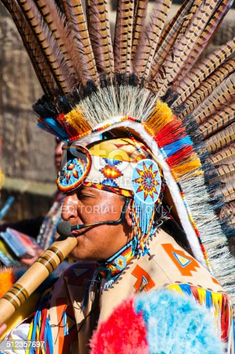 York, United Kingdom - August 9, 2014: Native American Indian tribal group play music and sing on the street in historical city of York, England.