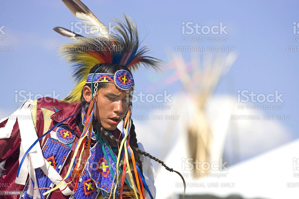 Native American man in full dress. stock photo