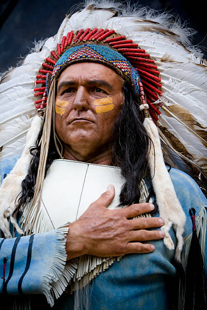 Native American Man Wearing Headdress stock photo