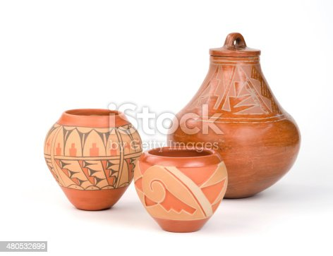 Three Native American Pueblo Pottery, isolated on white..