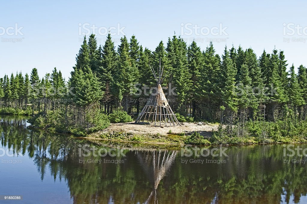 Native American tipi on a lakeshore royalty-free stock photo