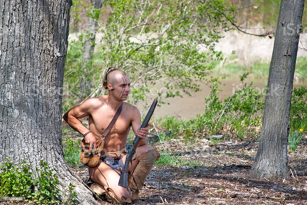 Native American warrior with rifle stock photo