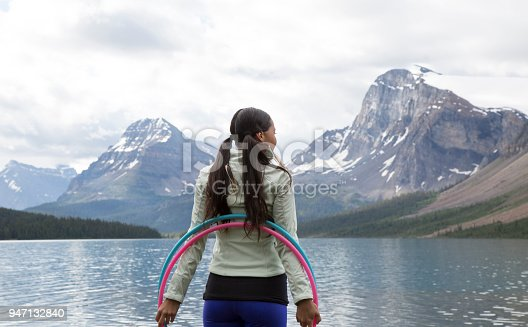 istock Native American woman dances with hoops, in mountains 947132840