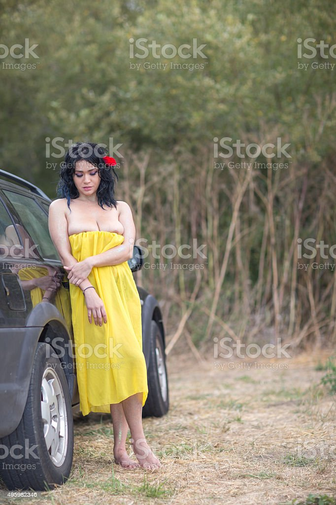 Native American woman lying on the car stock photo