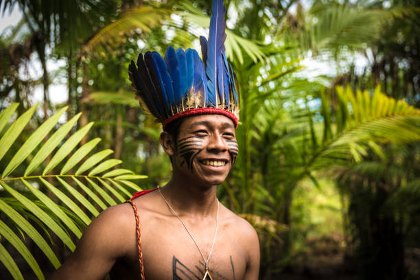 native brazilian man from tupi guarani tribe in brazil (indio) - indigenous culture stock pictures, royalty-free photos & images