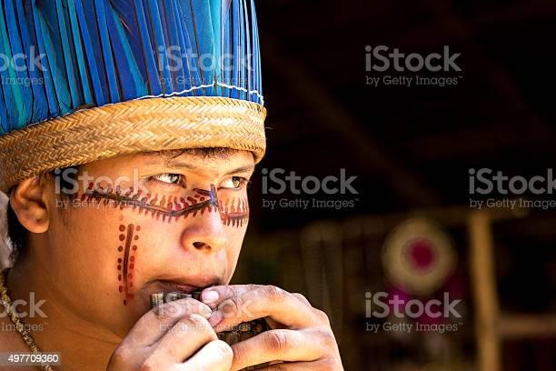 Native Brazilian playing wooden flute