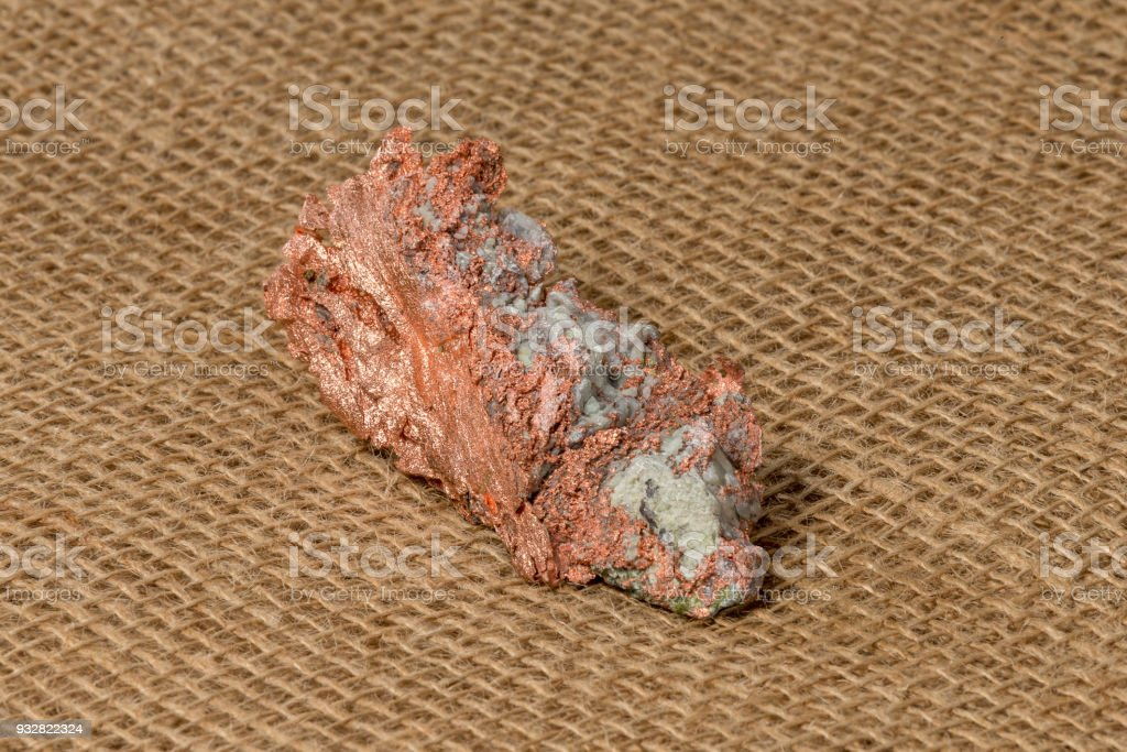 Native Copper Nugget on Burlap Background stock photo