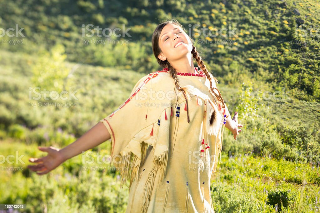 Native Indian maiden dances in the prairie royalty-free stock photo