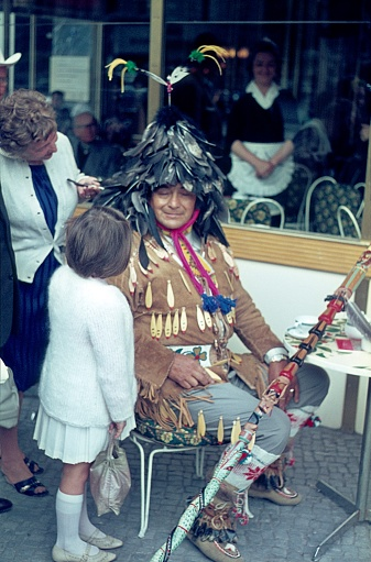 Native Indians in conversation with a girl and her mother on a café terrace on St. Pauli, Hamburg