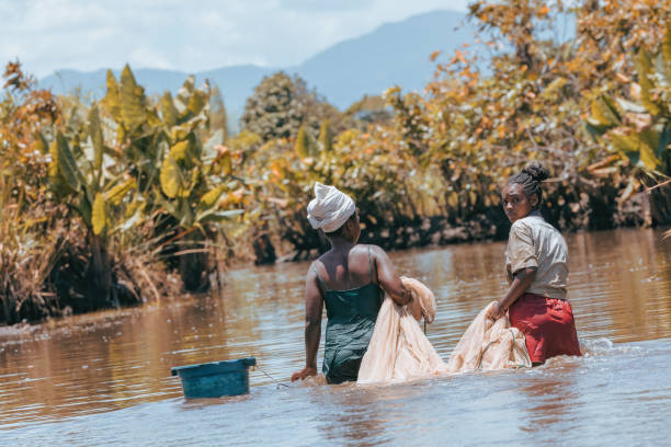 Native Malagasy fishermen woman fishing on river, Madagascar stock photo