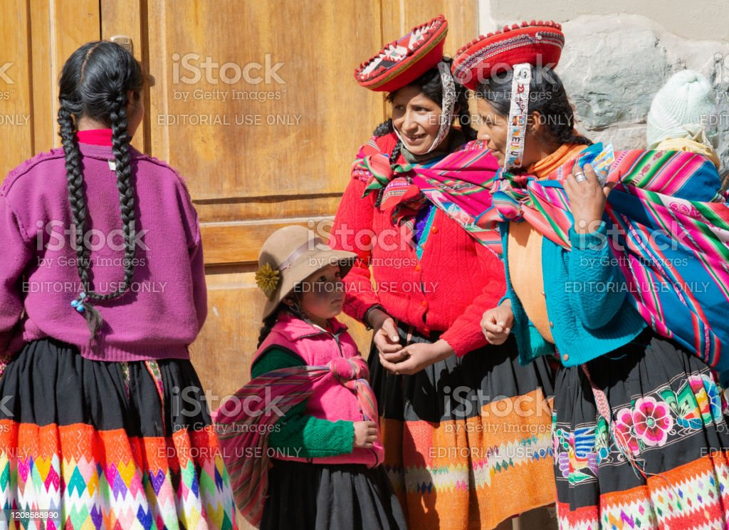 Native Peruvian Women And A Small Girl Dressed In Traditional Clothing From The Cusco Region Stock Photo Download Image Now Istock