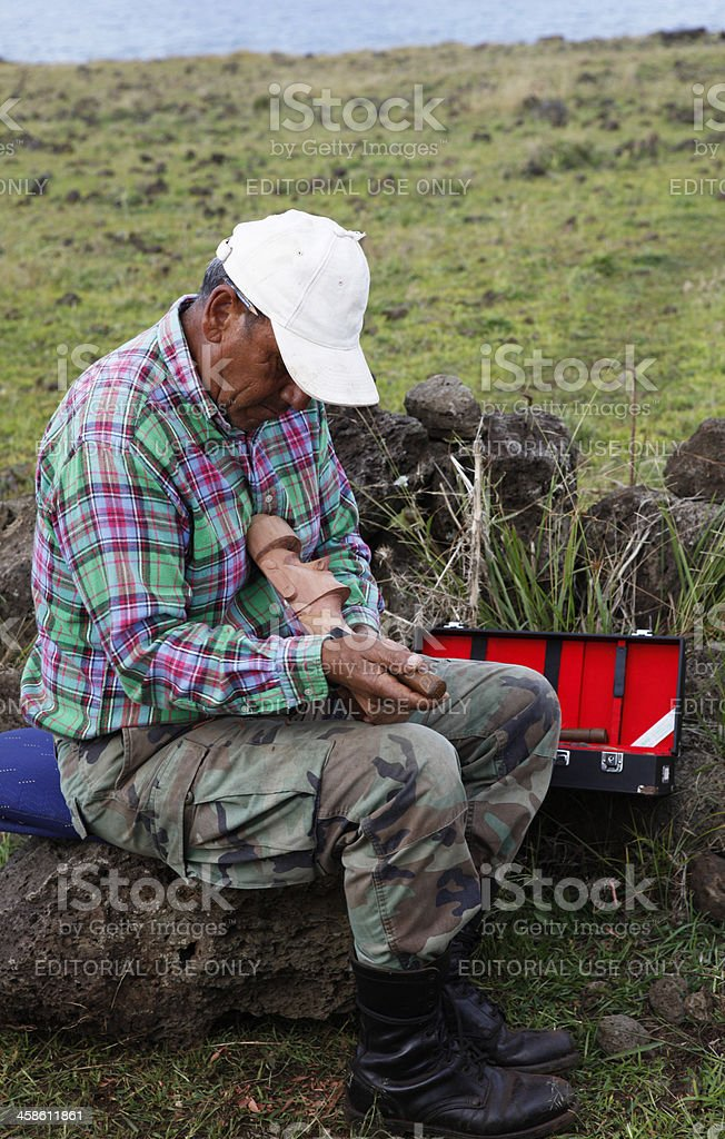Native Rapanuian Man Carving a Statue stock photo
