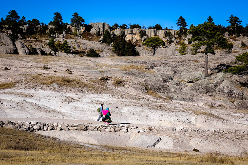 A native Raramuri couple walks through the barren landscape of the Valley of the Monks in Creel, near the Copper Canyon in northern Mexico