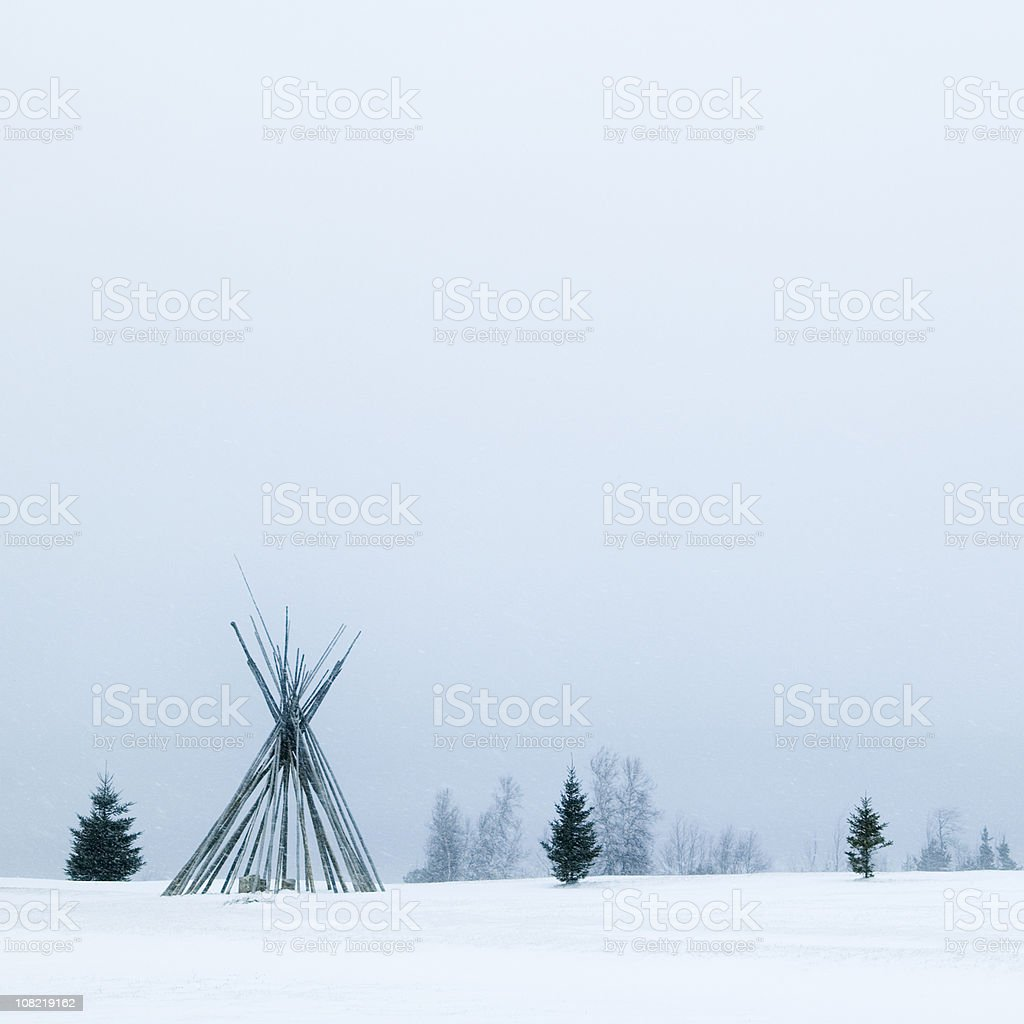 Native Tepee Frame During Winter Snowstorm royalty-free stock photo
