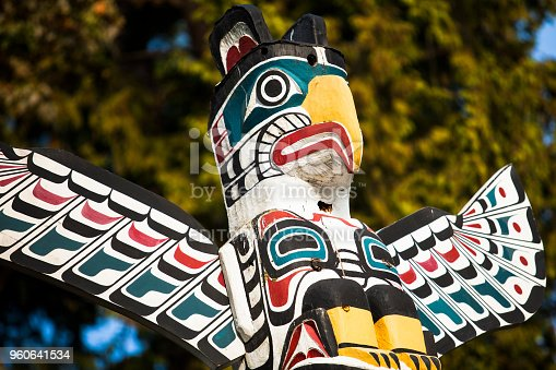 Vancouver, Canada - September 07, 2010:  Native American Indian totem pole in Stanley Park, Vancouver British Columbia.  Totem poles are monumental carvings, a type of Northwest Coast art, consisting of poles, posts or pillars, carved with symbols or figures. They are usually made from large trees, mostly western red cedar, by indigenous peoples of the Pacific Northwest coast of North America