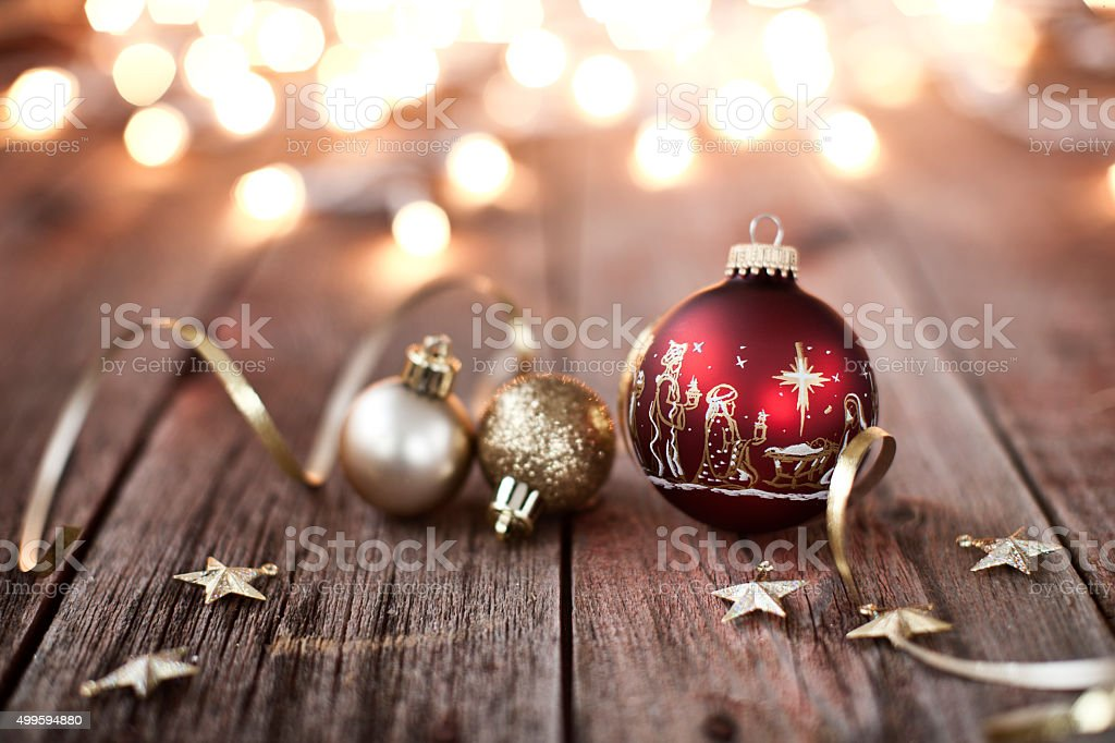 nativity christmas ornaments with decorations and ribbon on wood background royalty free stock photo