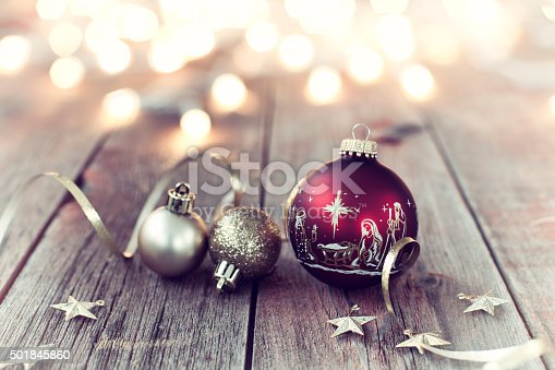 istock Nativity Christmas Ornaments with Decorations and Ribbon on Wood Background 501845860
