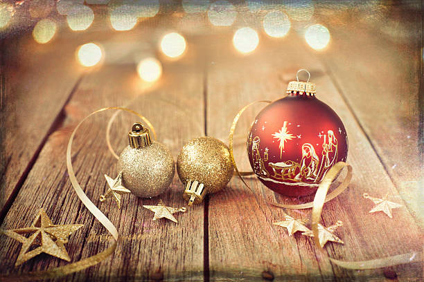 nativity christmas ornaments with decorations and ribbon on wood - vintage ornaments stock photos and pictures