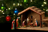istock Nativity scene next to a Christmas tree 114414239
