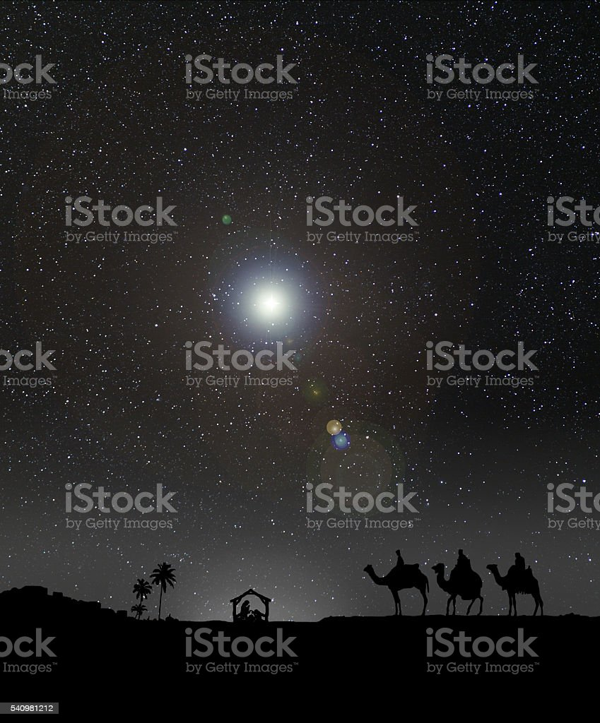 Nativity scene with 3 wise men and the Christmas star. stock photo