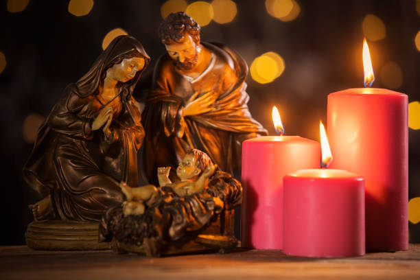 nativity scene with burning candles - nativity scene stock pictures, royalty-free photos & images