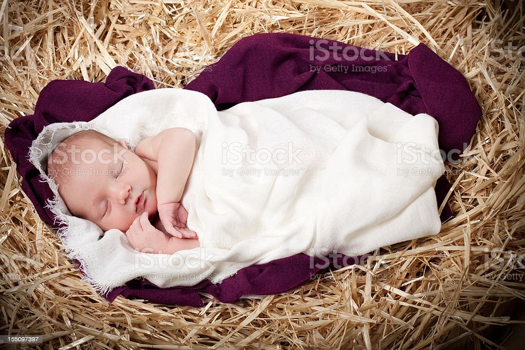 Nativity with Baby Sleeping in Manger stock photo