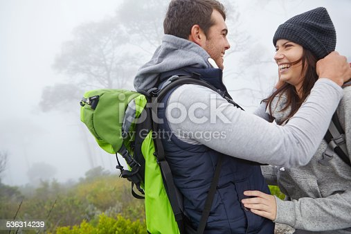 Shot of a loving young couple being affectionate while out on a hike