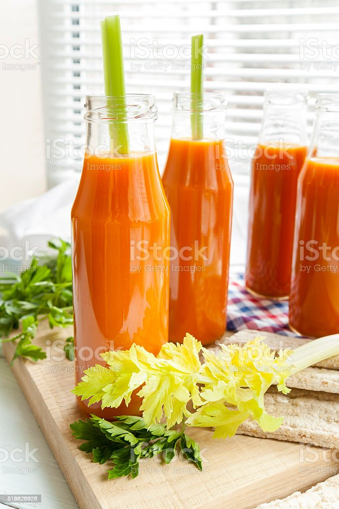 Natural and fresh carrot juice in small bottles royalty-free stock photo
