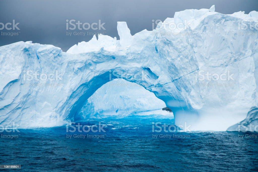 Natural Arch in Iceberg Antarctica stock photo