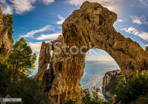 The Arco Naturale is a natural arch on the east coast of the island of Capri. Dating from the Paleolithic age, it is the remains of a collapsed grotto. The arch spans 12 m at a height of 18 m above ground and consists of limestone.