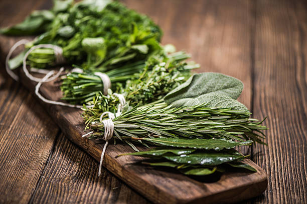 natural aromatic herbs - basil stock photos and pictures