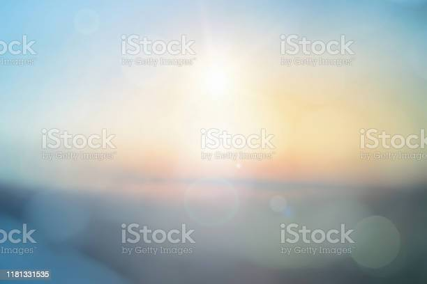 Photo of Natural background blurring warm colors and bright sun light. Bokeh or Christmas background Green Energy at sky sunny color orange light patterns plain abstract flare evening clouds blur.