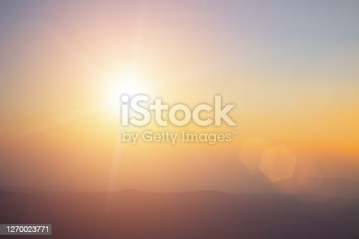 istock Natural background blurring warm colors and bright sun light. Bokeh or Christmas background Green Energy at sky sunny color orange light patterns plain abstract flare evening clouds blur. 1270023771