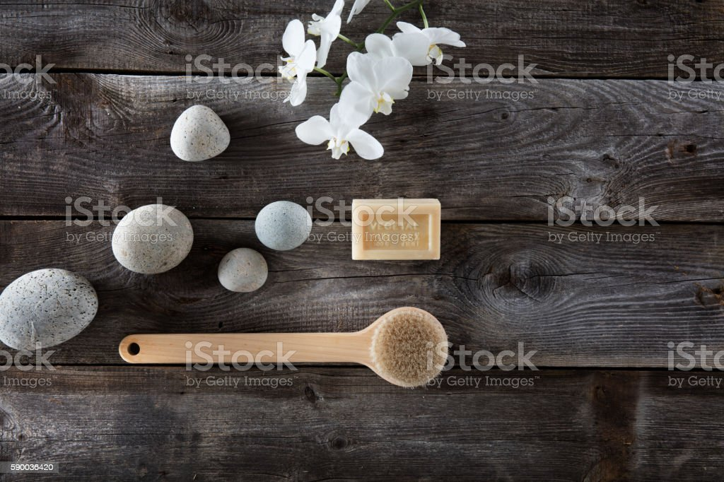 natural bath concept with pebbles, back brush and white orchids stock photo