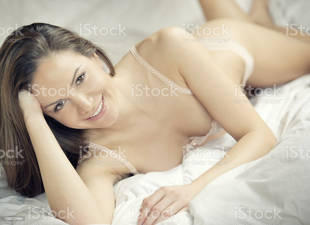 Natural Beauty lying in Bed (XXXL) royalty-free stock photo