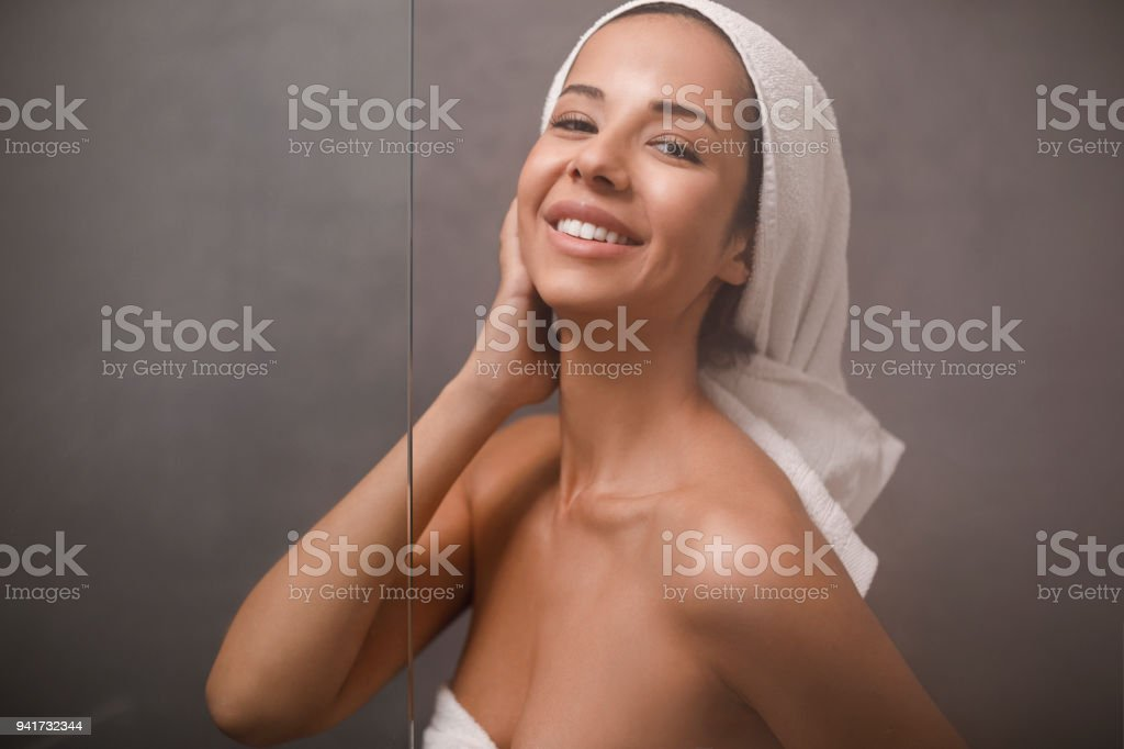 a5aeb43a6e Natural Beauty Portrait beautiful young woman with a towel wrapped around  her hair, after showering. In the bathroom. - Stock image .