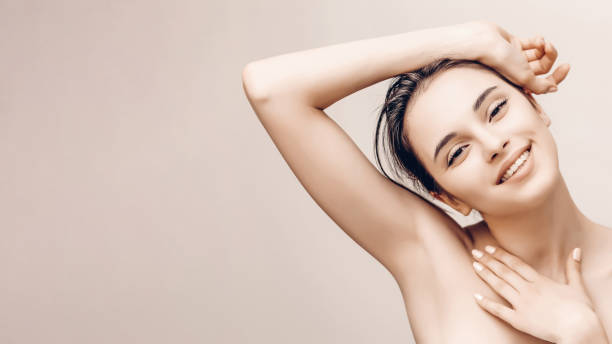 Natural beauty portrait of female face and body with perfect skin. Deodorant advertising and hair epilation concept Natural beauty portrait of female face and body with perfect skin. Deodorant advertising and hair epilation concept. laser stock pictures, royalty-free photos & images