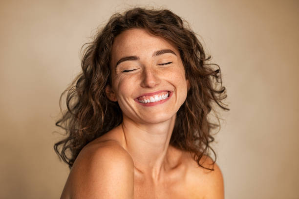 Natural beauty woman laughing with joy stock photo