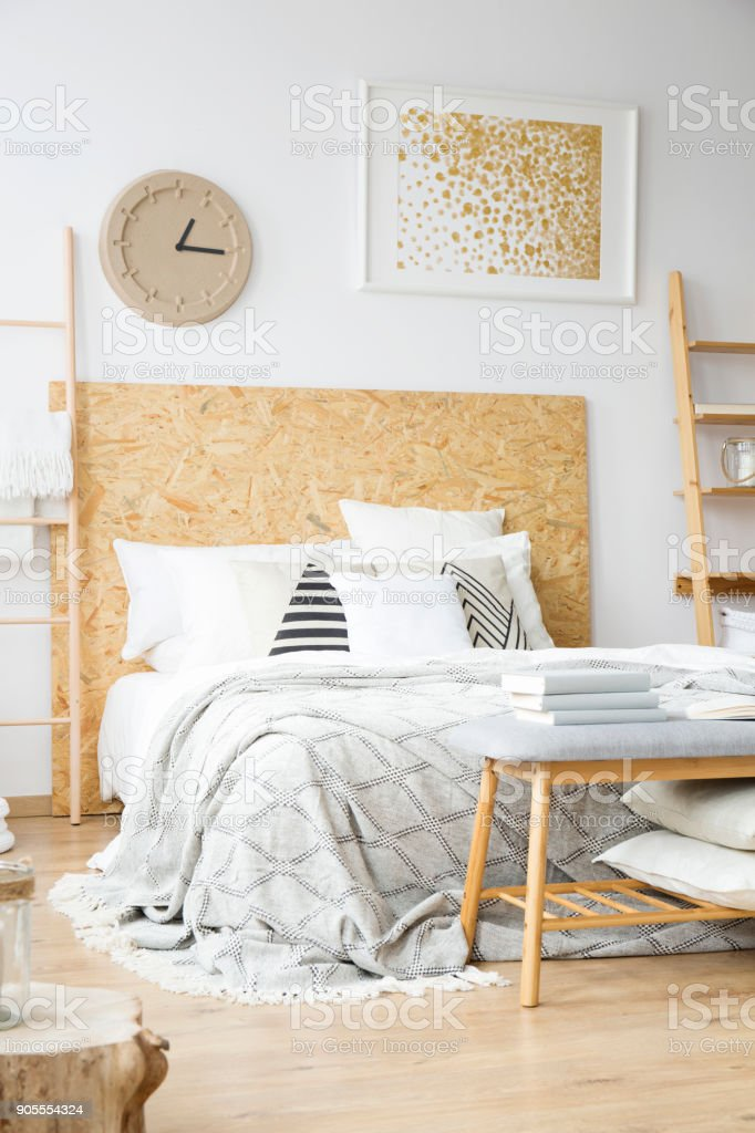 Natural bedroom with gold painting stock photo