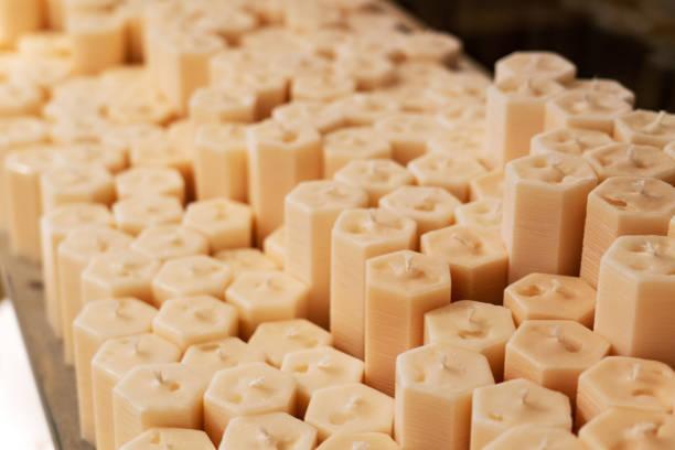 Natural beeswax candles photo. Candles making production. stock photo
