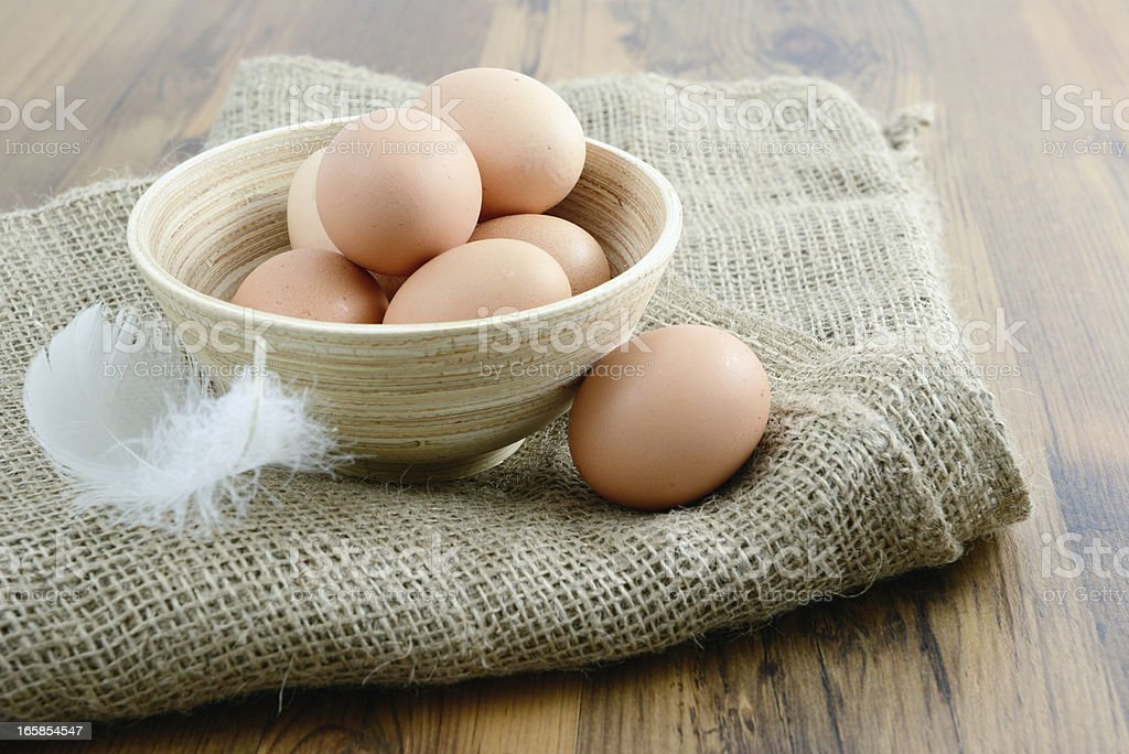 natural beige eggs in a cup royalty-free stock photo