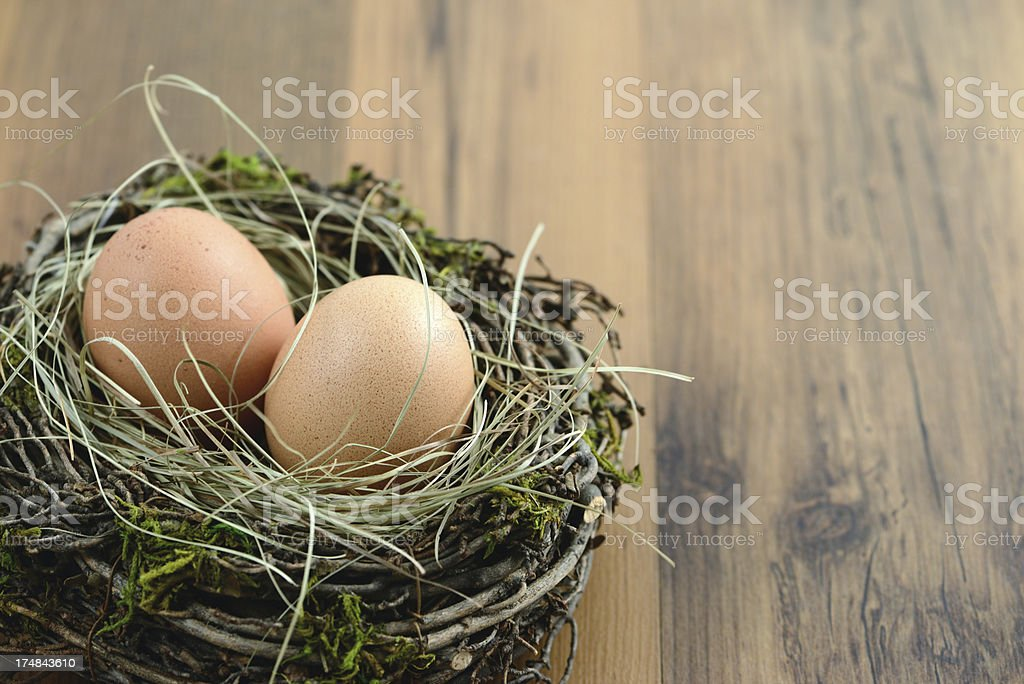 natural beige eggs in a nest royalty-free stock photo