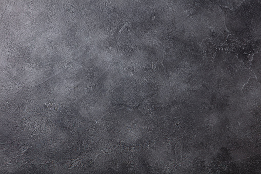 istock Natural black slate stone background pattern with high resolution. Top view. Copy space. 1204580359