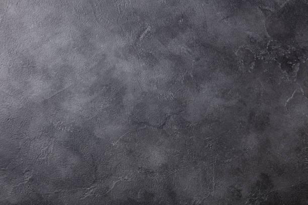motivo di sfondo in pietra di ardesia nera naturale ad alta risoluzione. vista dall'alto. copiare lo spazio. - calcestruzzo foto e immagini stock