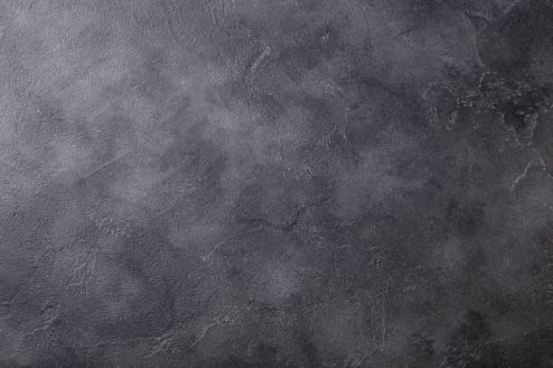Natural black slate stone background pattern with high resolution. Top view. Copy space. stock photo