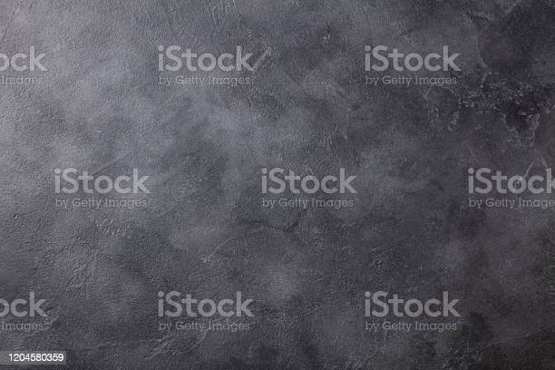 Photo of Natural black slate stone background pattern with high resolution. Top view. Copy space.