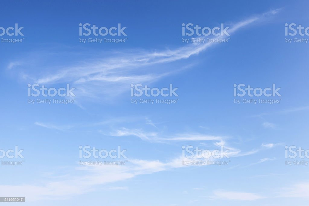 Natural blue windy cloudy sky background texture stock photo