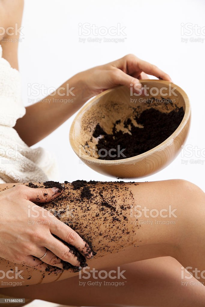 Natural body care. Cellulite massage with coffee scrub. stock photo