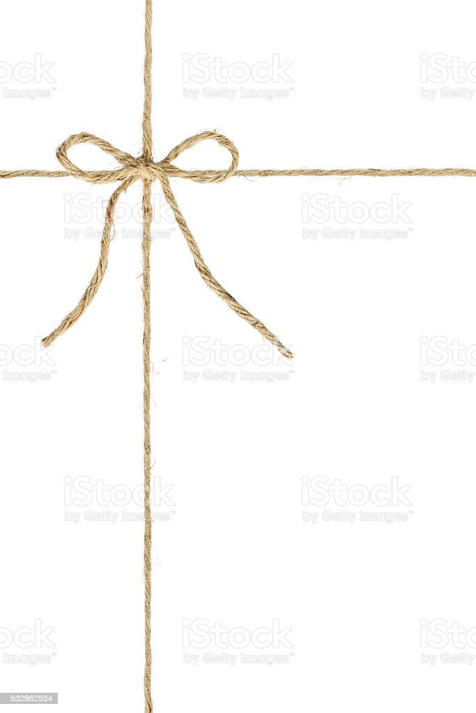 Natural brown jute twine hemp rope with knot in middle stock photo