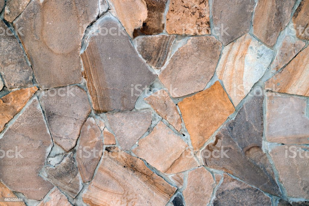 Natural building material, multi-colored sandstone wall texture royalty-free stock photo